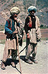 AFG89LEE1_06 Two young Pushtun tribe men, nomadic camel drivers: traditional dress in many layers, and turbans. Central Afghanistan. Copyright Tropix (J. Lee)