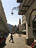 ARG07RB018 Street cobbled in quarter circle pattern, arcade, pedestrians, colonial buildings & hills. Salta city, N.W.Argentina. Copyright Tropix (Roland Birley)