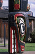 CAN04TX3_07 Lower head of totem pole with crocodile grin in front of hut. Thunderbird Park, Vancouver, BC, Canada. Copyright Tropix (V. and M. Birley)