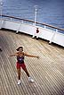CAR94LS1_02 Woman doing aerobics aboard cruise ship; Carribean cruise, Caribbean Sea. Copyright Tropix (Lynn Seldon)