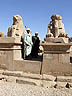 EGY09BB247 Two guides stand between sphinxes outside ancient landmark. Avenue of the Sphinxes, Karnak Temple, Luxor, Egypt Copyright Tropix (Bethany Birley)