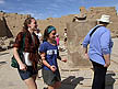 EGY09VJB531 Cheerful tourists circumnavigating scarab beetle statue for good luck; Temple of Karnak, Luxor (ancient Thebes), Egypt. Copyright Tropix (V. and M. Birley)