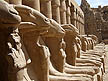 EGY09VJB554 Ram-headed sphinxes; small statues of pharaoh Ramesses II between paws; Temple of Karnak, Luxor (ancient Thebes), Egypt. Copyright Tropix (V. and M. Birley)
