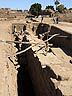 EGY09VJB662 Archaeologists / restoration workers excavating deep buried stone wall. Temple of Karnak, Luxor (ancient Thebes), Egypt. Copyright Tropix (V. and M. Birley)