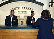 EGY09VJB701 Tourism jobs: woman staff member talks to smart young men receptionists. Sofitel-Karnak Hotel, Luxor, Upper Egypt. Copyright Tropix (V. and M. Birley)