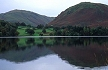 ENG00TX6_10 Curvy, undulating mountains reflect in calm water of Ullswater, one makes near spherical shape. Lake District, England. Copyright Tropix (V. and M. Birley)