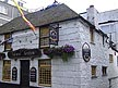 ENG06MHB144 Admiral Benbow pub, C17th, famous in Treasure Island; figure with musket on roof. Historic Penzance, Cornwall, England. Copyright Tropix (M & V BIRLEY)