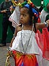 ENG06VJB340 Caribbean girl (6 yrs?) in red/white costume, hair in cornrows with extensions, bobbles. Kingston Carnival, England. Copyright Tropix (V. and M. Birley)