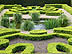 ENG09VJB334 Box topiary surrounds pond with ornamental grasses, pattern. Privy Gardens, Hampton Court Palace, Surrey, England. Copyright Tropix (V. and M. Birley)