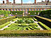 ENG09VJB348 Maze of box topiary surrounds pond with ornamental grasses, Privy Gardens. Hampton Court Palace, Surrey, England. Copyright Tropix (V. and M. Birley)