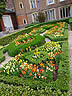 ENG09VJB360 Restored Knot Garden bordered by colourful wallfowers & hedges. Hampton Court Palace, Kingston, Surrey, England. Copyright Tropix (V. and M. Birley)