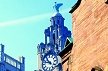 ENG_XS12 View through brick buildings to close-up of Liver Building Bird and clock; blue sky. Liverpool, England. Copyright Tropix (Christian Smith)