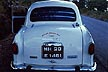 IND97TX271E Rear view Ambassador car, white, parked at roadside, door open; number plate in 2 alphabets. Maharashtra, India. Copyright Tropix (V. and M. Birley)