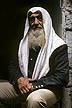 ISR81TX001E Old man, Palestinian Arab, with long beard & head covered with white keffiyeh (scarf); Old City, Jerusalem, Israel. Copyright Tropix (V. and M. Birley)