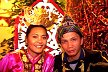 MLS96AFL1_22 Bajau tribe: attractive young couple, smiling woman, both in traditional, colourful dress, headgear. Sabah, Malaysia. Copyright Tropix (Alastair Fuad-Luke)