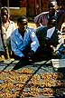 MLW96RUS6_23 Roasted grasshoppers on market stall with vendors; insect food, nutritious local delicacy. Zomba, Southern Rgn, Malawi Copyright Tropix (Russ Clare)