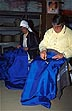 NAM94IDS25_04 Women (one blind, with headscarf) sew bright blue mailbags. Ehafo disabled workers enterprise, Windhoek, Namibia. Copyright Tropix (IAN SPARK)