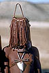 NAM94SW1_02 Himba tribe girl age 11; face beads show she is unmarried; neck Ekipa (jewellery); ochre body-paint. Koakoveldt. Namibia Copyright Tropix (Simon Wicks)