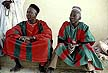 NIG87DD1_15 Two men, the Emirs guards, seated, in traditional red/green striped robes; costume. Gumel town, Kano State, N.Nigeria. Copyright Tropix (D. Davis)
