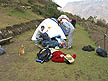 PER07RB197 Cat watches tourists prepare to camp on mountainside. Choquequirao trek, Sacred Valley, Andes, Peru. MODEL RELEASED Copyright Tropix (Roland Birley)