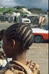 SAF98PAM1_04 Back view head of girl, c.12, with braided hair style. Vrygrond informal settlement, Cape Town, South Africa. Copyright Tropix (Pam Howarth)