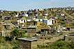 SAF_AM27_07 Tidy squatter settlement on gentle hill, mostly mud & pole houses with metal roofs, well spaced. Durban, South Africa. Copyright Tropix (A. Mountain)