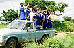 SAF_AM7_20 Secondary school students, uniform, pointing from pickup truck; nature & wildlife field trip. KwaZulu Natal, S.Africa. Copyright Tropix (A. Mountain)