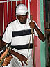 TRN07RB055 Percussionist & mandolin player, Parang music in bar, man with white cap. Petersville, Trinidad. Copyright Tropix (Roland Birley)
